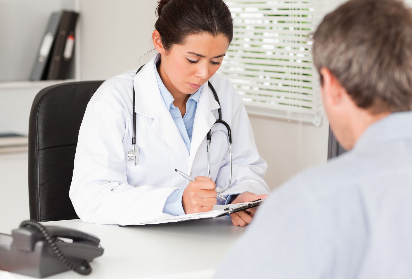 bigstock-Pretty-Female-Doctor-Consultin-21974384
