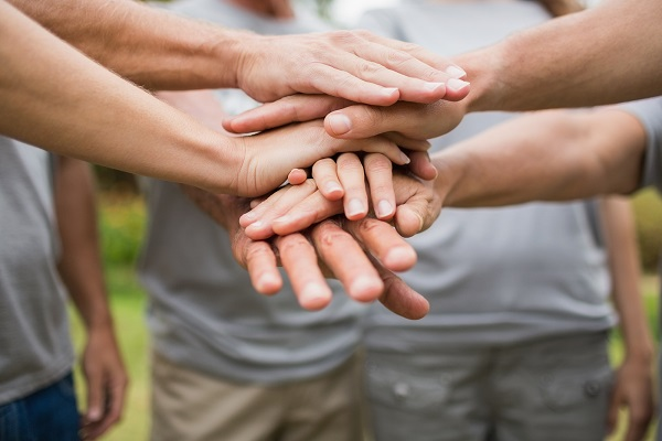 bigstock-Happy-volunteer-family-putting-91115999