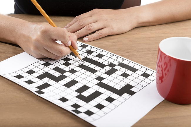 bigstock-Solving-crossword-puzzle-with-142818521