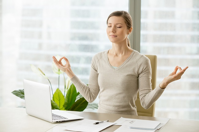 bigstock-Relaxed-Woman-Meditating-At-Wo-227496403