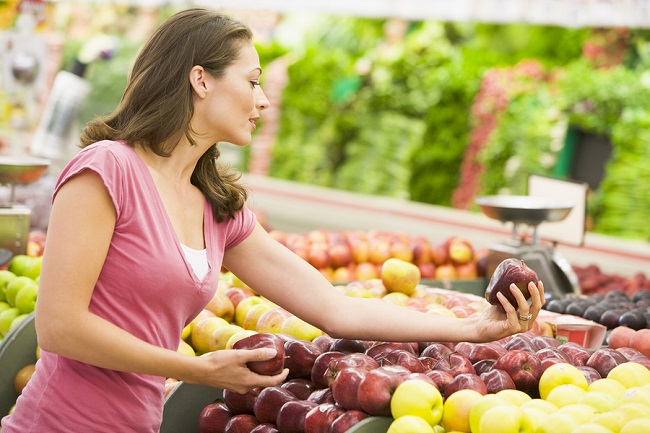 bigstock-Woman-Choosing-Fruit-In-Shop-3915452