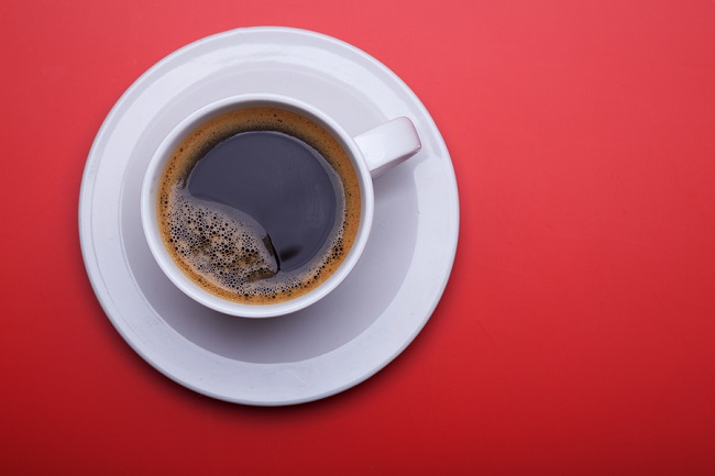bigstock-Cup-of-black-coffee-on-table-t-268972141