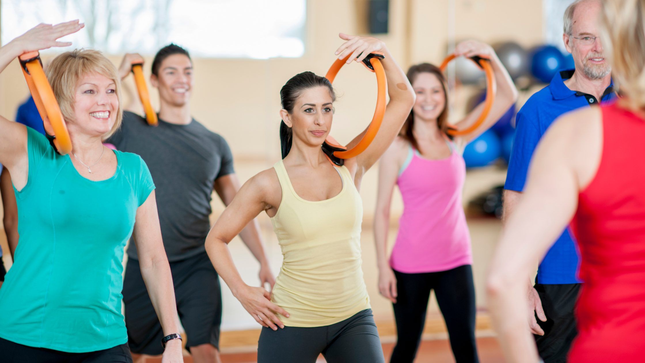 Group of people performing resistance exercise training
