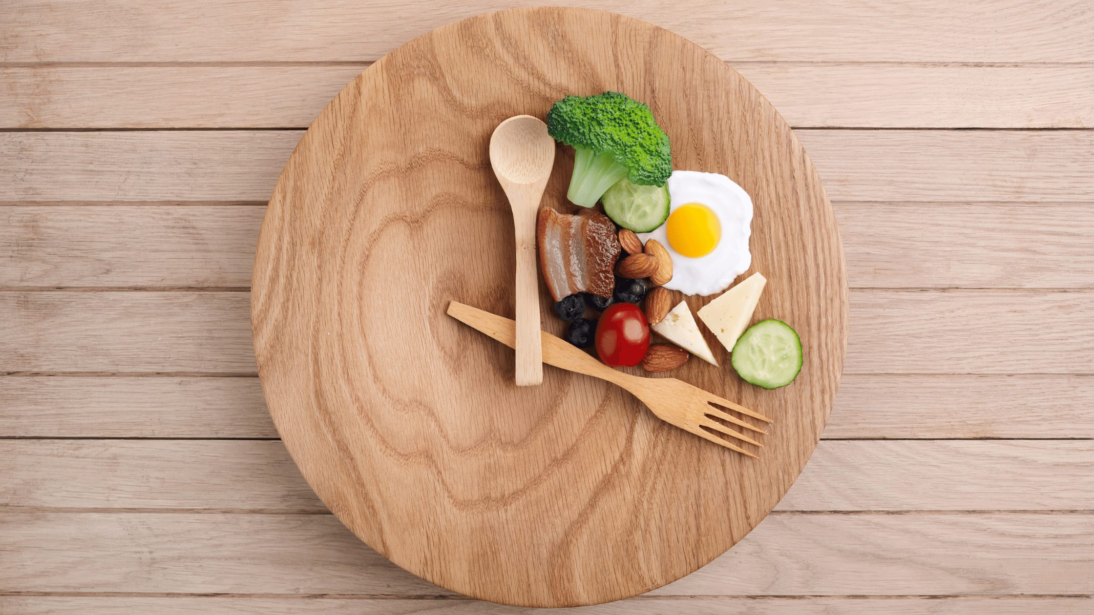 Symbolizing intermittent fasting with food displayed on plate as a clock